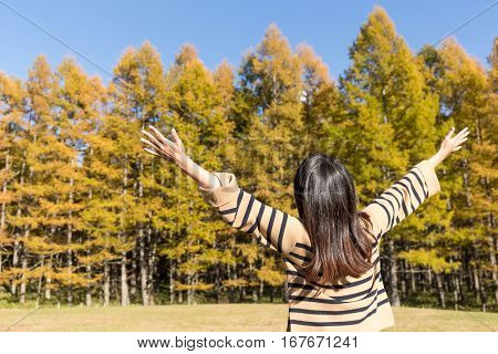 Woman breeze in autumn forest