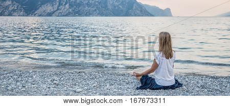 serenity and yoga practicing at the lake Garda