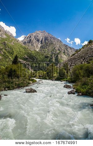 Beautiful mountain landscape with river at Tian Shan mountains. Kyrgyzstan