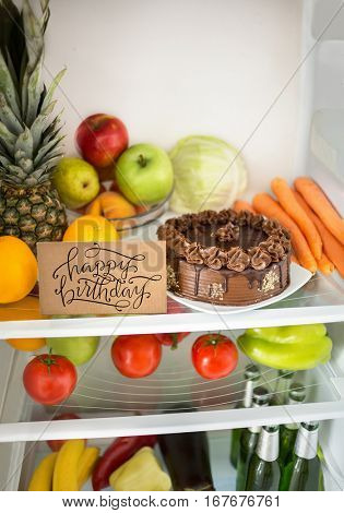 Chocolate cake for birthday surprise in fridge