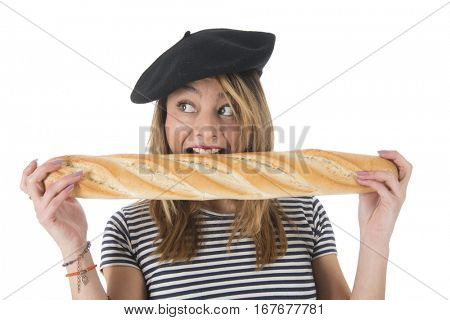 Young French girl with typical French barret and striped shirt eating bread isolated over white background