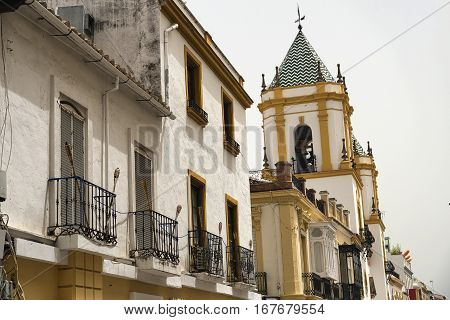 Ronda (Andalucia Spain): facade of old typical buildings with balconies and verandas