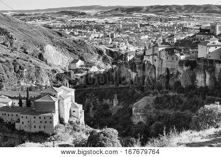 Cuenca (Castilla-La Mancha Spain) the famous casas colgadas Unesco World Heritage SIte and the San Pablo convent. Black and white
