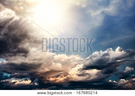 Dramatic Cloudscape Background with Sun and Blue Sky