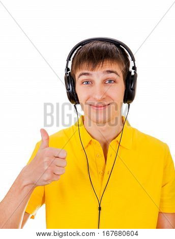 Young Man in Headphones with Thumb Up Gesture Isolated on the White Background