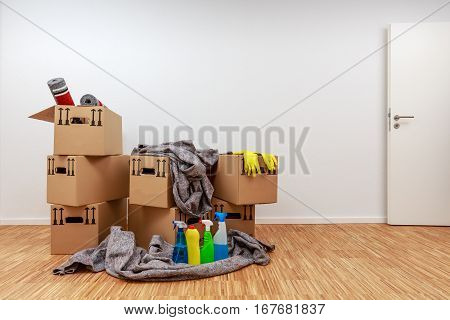 Renovated Room With Filled Moving Cartons And Cleaning Agents
