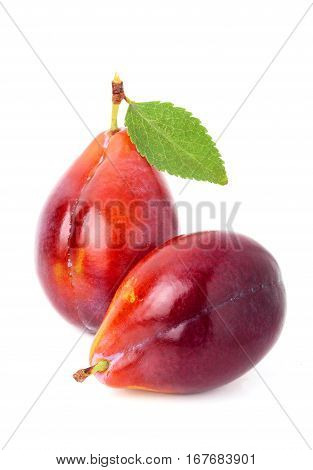 Ripe red plum with leaf.Isolated on white background.