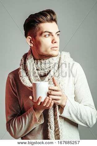 Handsome Guy With Cup In Scarf
