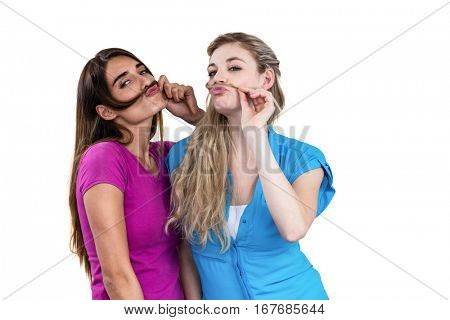Mischievous friends playing with hair on white background