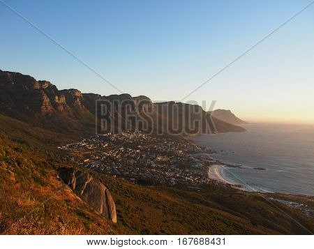 Table Mountain national park view near city and the beach with sunset in Camps Bay, Cape Town, South Africa. Take from Lion's Head mountain.