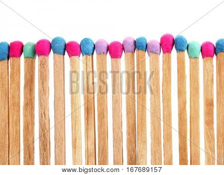 Colorful matches perfectly sharpened placed in level row