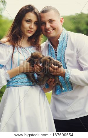 Couple Dressed In Ukrainian Ethnic Style Holds Little Polecats