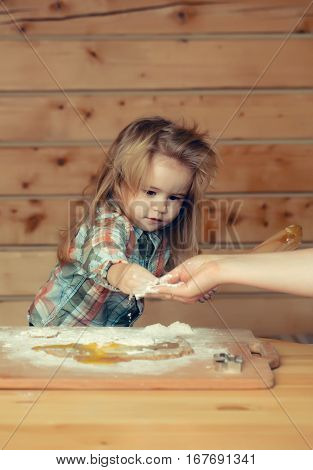 Female Hands Help Child Cooking With Dough, Flour, Egg
