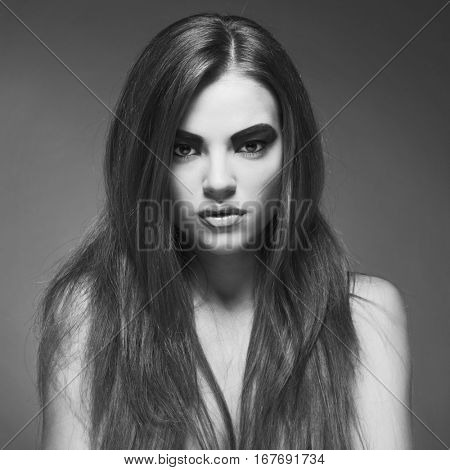 Fashion photo of beautiful lady with healthy long hair