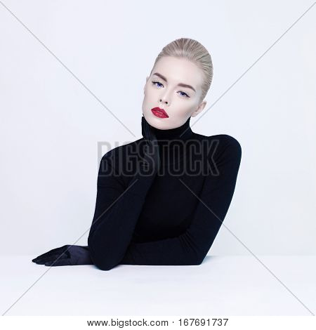 Fashion studio portrait of beautiful blonde woman