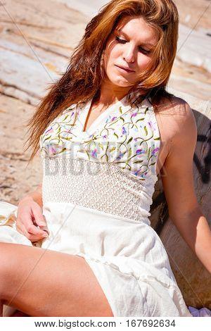 Pretty brunette woman wearing white dress