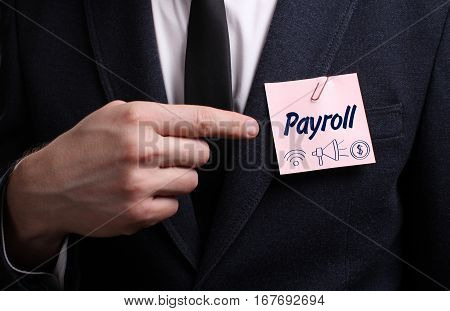 Business, Technology, Internet And Network Concept. Young Businessman Shows The Word: Payroll
