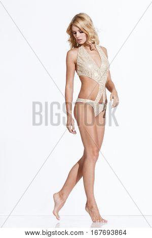 Young woman in bikini posing on white background