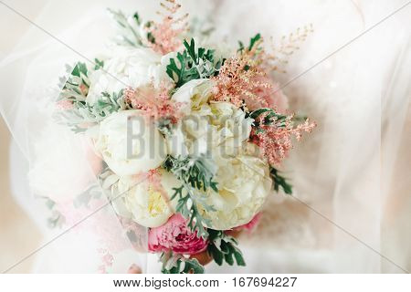 Wedding Bouquet With White And Pink Flowers In The Bride's Hands