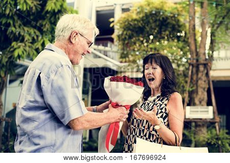 Mature couple woman bouquet of flowers