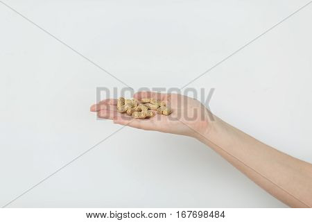 Hand Is Giving Tablets On White Background.