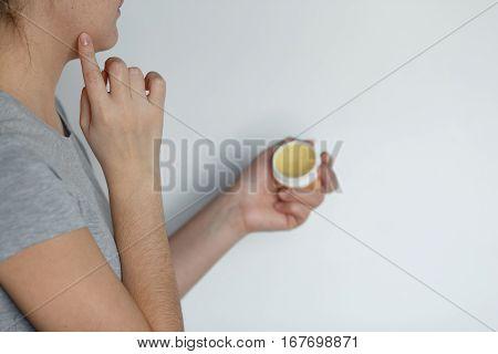 Female Applying Balm Moisturizing Balsam.