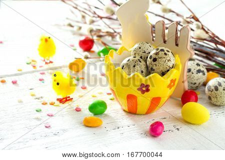 Cooking Recipe Background For Easter Celebration: Quail Eggs Are, Candy And Twigs Of Willow On A Whi