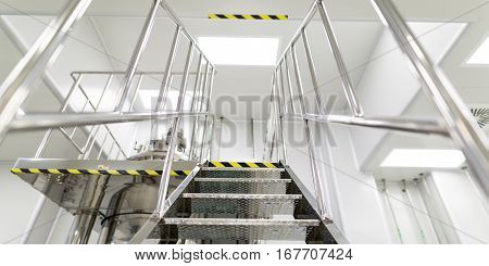 from bellow big chromed stairs in pharmaciutical factory