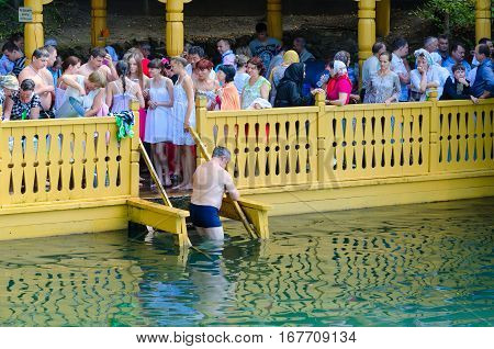 TSYGANOVKA RUSSIA - AUGUST 22 2015: Pilgrims are on holy source in name of St. Seraphim of Sarov near village of Tsyganovka Russia