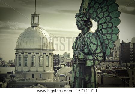 Angel monument and the dome of Bonsecours market in old Montreal, Canada