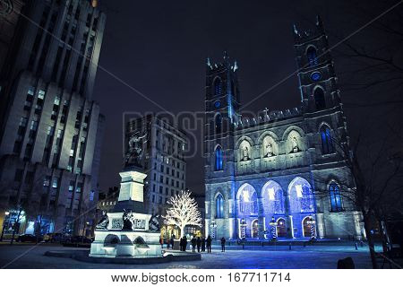 Popular Place d'Armes, Montreal, Quebec, Canada in front of Notre dame Cathedral during winter time in Montreal, Canada