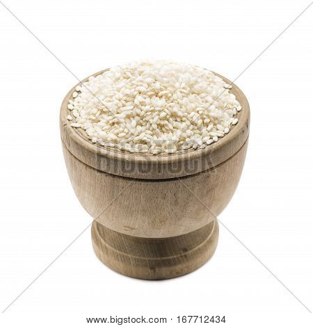 heap of white rice in wooden bowl on white background.