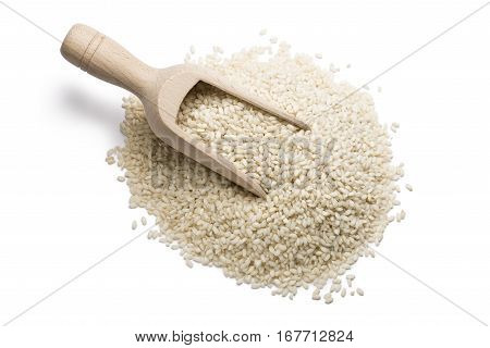 heap of white rice with wooden scoop on white background.