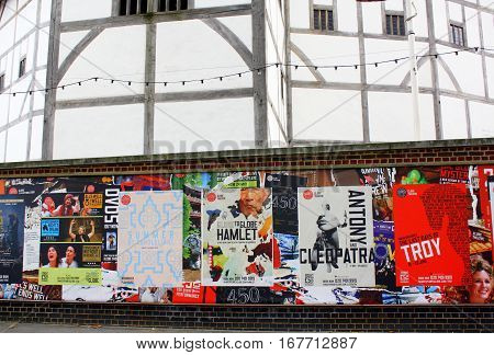 London, England - August 21, 2014: Posters advertising performances at the Globe Theatre In London. The Globe is a reproduction of the original building where Shakespeare staged his plays