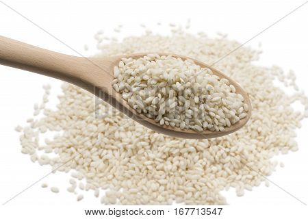 heap of white rice in wooden spoon on white background.