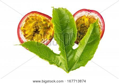 Halves Of Red  Passion Fruits And  Green Leaves