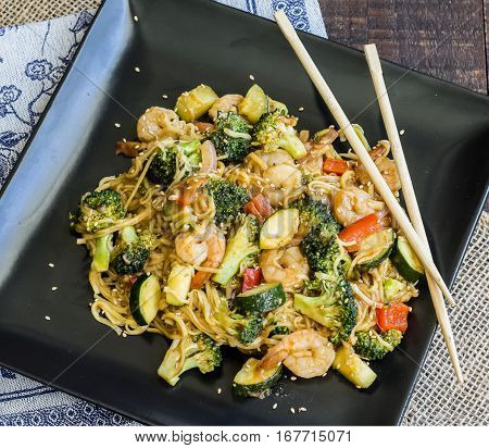 Shrimp and fresh vegetables cooked till tender surrounded in a delicious homemade sauce and tossed in chow mein noodles.