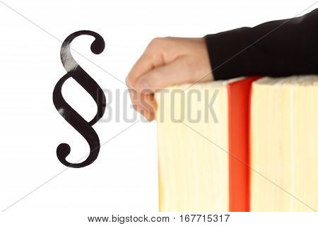 symbolic law with hands and law book in background