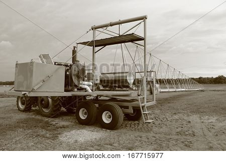 Black and white shot of irrigation machinery on a farm