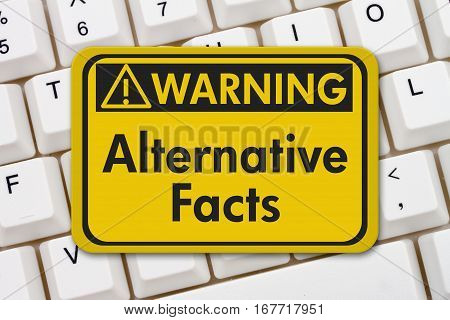 Alternative Facts warning sign A yellow warning sign with text Alternative Facts on a keyboard 3D Illustration