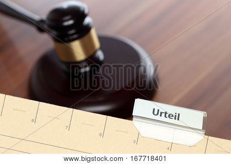 card index with verdict text and gavel in background