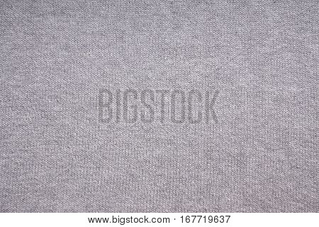 gray knitted background, close-up of grey knitwear sweater