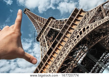 Eiffel tower in Paris on blue sky background wide angle measuring tower palm