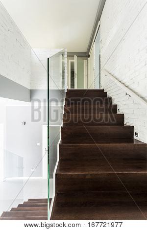 Dark Wooden Staircase With Transparent Railing
