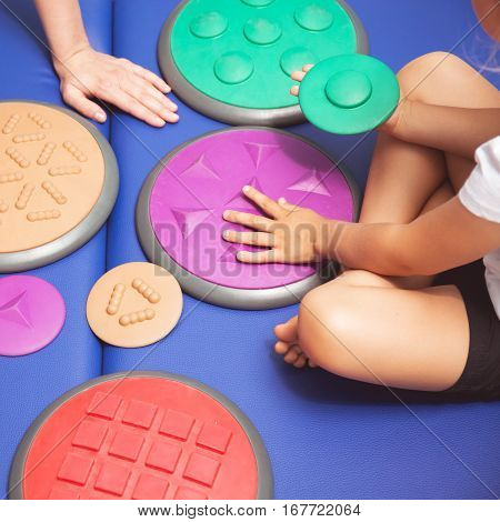 Child Touching Sensory Integration Equipment