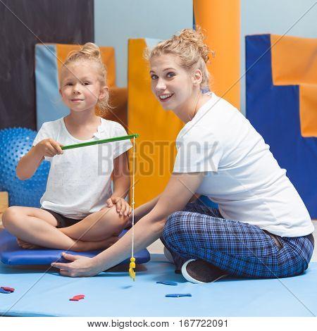 Sensory Integration Therapist Helping Child