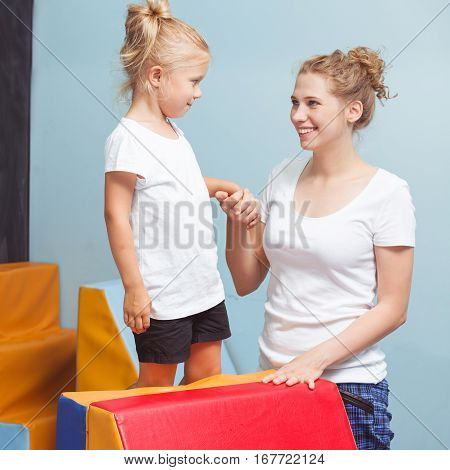 Female Tutor Helping Child