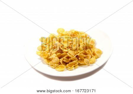 Falling flakes breakfast cereal isolated on white background. Healthy breakfast.