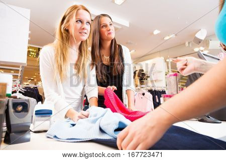customers talking to sales person in fashion store