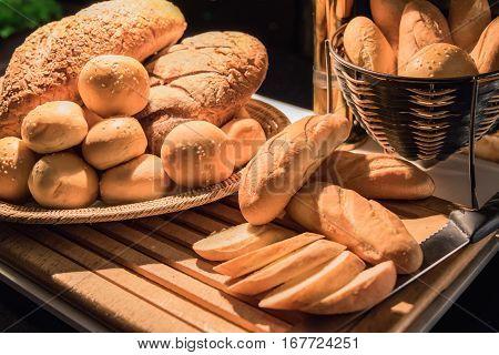 Fresh fragrant many homemade bread in studio selective focus